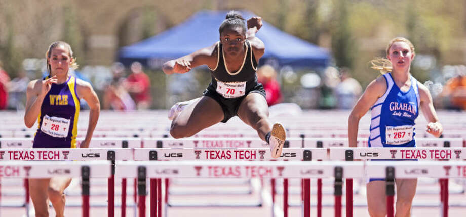 Andrews' Oceana Ridge leaps over a hurdle during the 100M hurdles finals during the Region 1 Track and Field Championship on Saturday at the Linda and Terry Fuller Track Complex in Lubbock. Ridge finished in first place with her 14.55 time. Photo: Brad Tollefson
