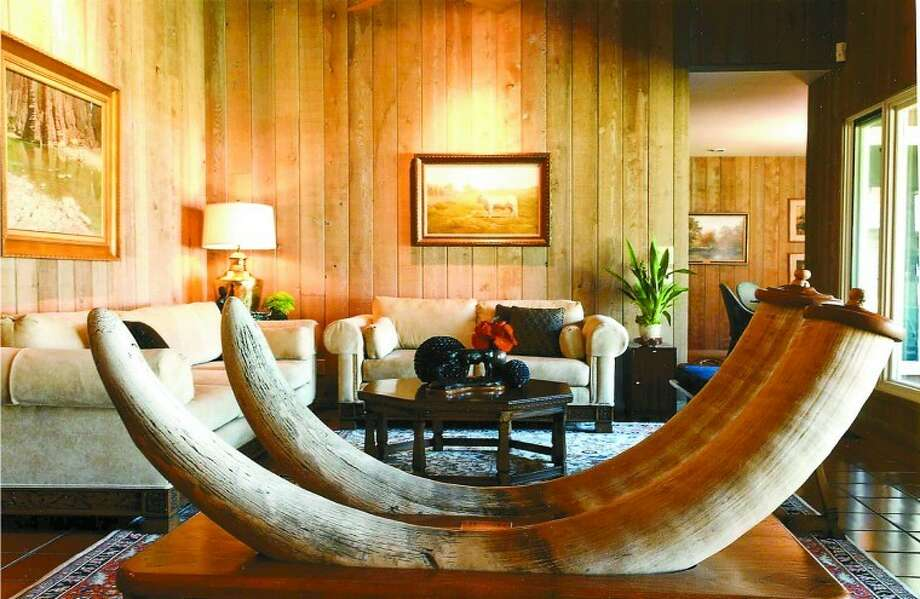 A table made with two elephant tusks is shown in the Ector County home of John Holdridge. Photo: Courtesy Photo