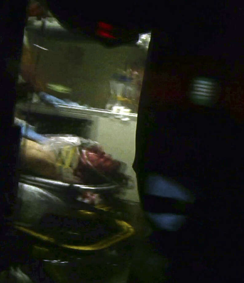 This still frame from video shows Boston Marathon bombing suspect Dzhokhar Tsarnaev visible through an ambulance after he was captured in Watertown, Mass., Friday, April 19, 2013. The 19-year-old college student wanted in the Boston Marathon bombings was taken into custody Friday evening after a manhunt that left the city virtually paralyzed and his older brother and accomplice dead. (AP Photo/Robert Ray) Photo: Robert Ray