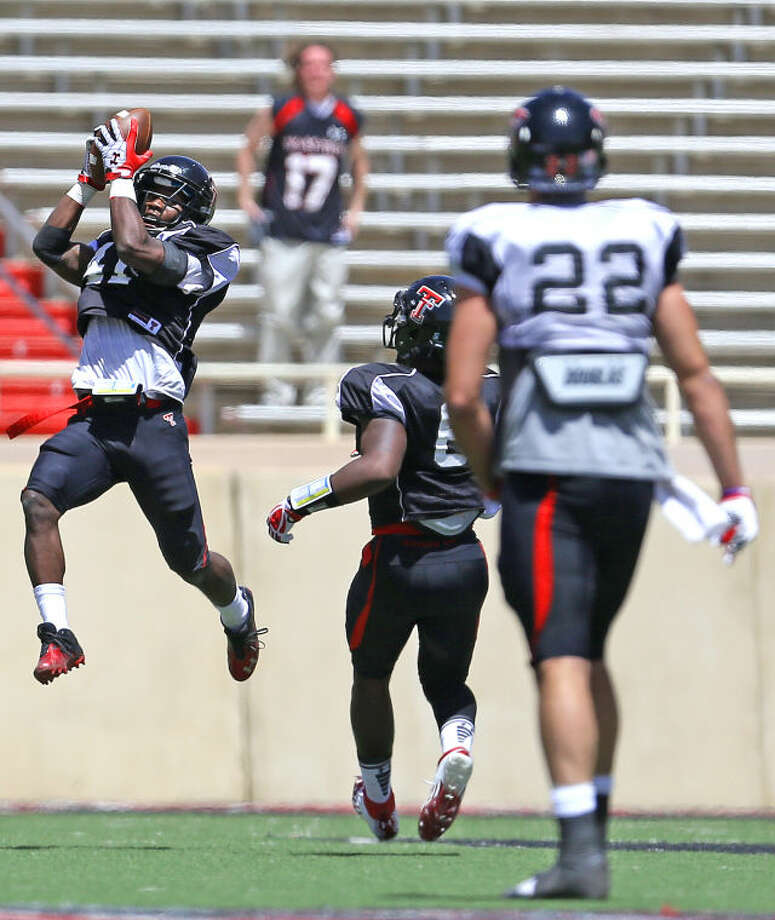 Texas Tech defensive back JJ Gaines (41) intercepts an errant passin Saturdays spring game at Lubbock's Jones AT & T stadium. Photo: Wade H Clay