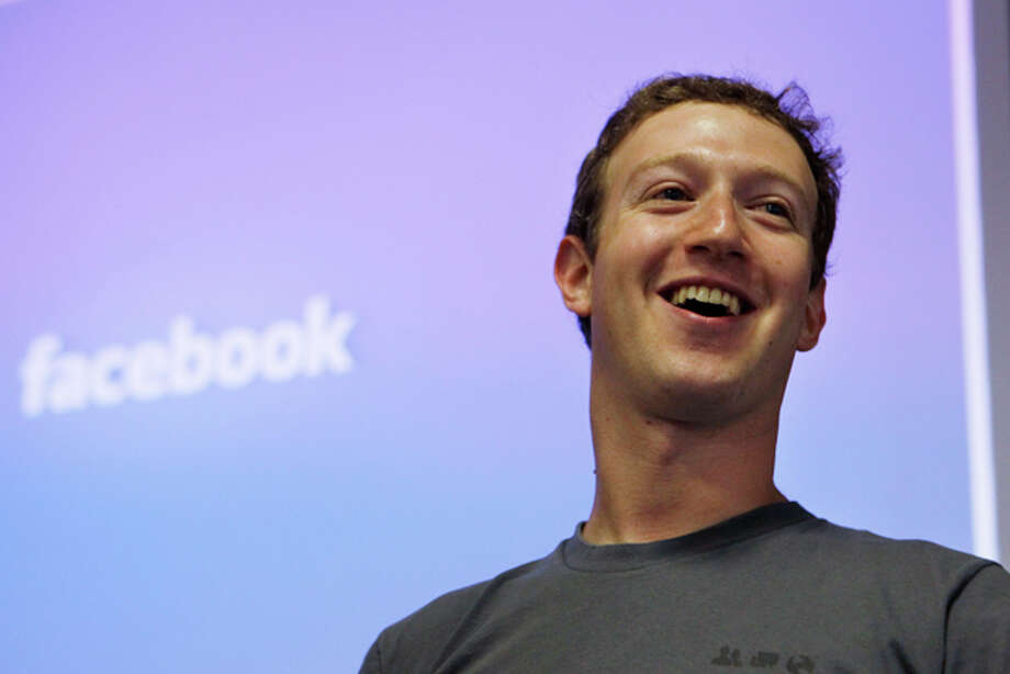 FILE - In this July 6, 2011 file photo, Facebook CEO Mark Zuckerberg smiles during an announcement at Facebook headquarters in Palo Alto, Calif. A Facebook security flaw, revealed this week, allowed users to gain access to the billionaire businessman's private pictures. (AP Photo/Paul Sakuma, File) Photo: Paul Sakuma / AP2011
