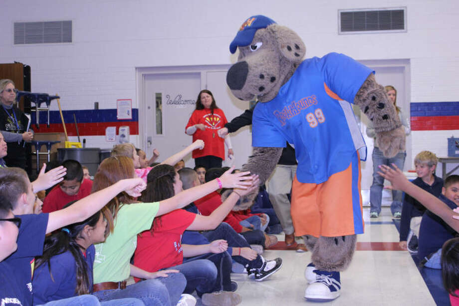 Rocky the Rock Hound high fives sixth grade students from Washington Math and Science Institute during a pep rally Friday afternoon. Third through sixth grade students throughout the state will take the standardized STAAR test this week. Meredith Moriak/Reporter-Telegram Photo: Meredith Moriak/Reporter-Telegra