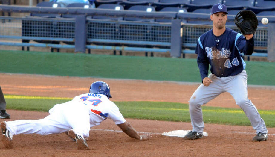 RockHounds' Jefry Marte beats the pick-off attempt by Corpus Christi first baseman Erik Castro Tuesday at Citibank Ballpark. James Durbin/Reporter-Telegram Photo: JAMES DURBIN
