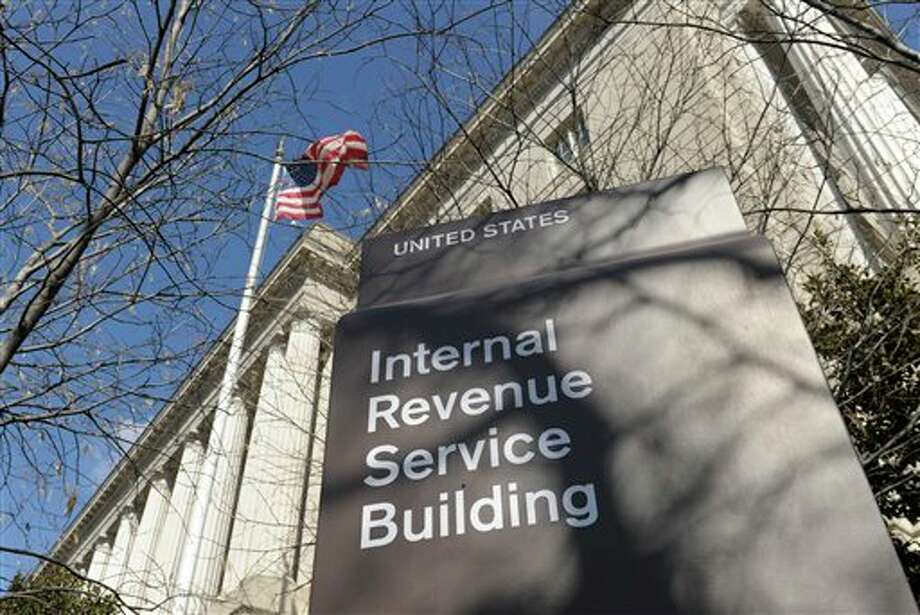 FILE - This March 22, 2013, file photo, shows the exterior of the Internal Revenue Service building in Washington. The Internal Revenue Service has recouped more than $5.5 billion under a series of programs that offered reduced penalties and no jail time to people who voluntarily disclosed assets they were hiding overseas, government investigators said Friday, April 26, 2013. In all, more than 39,000 tax cheats have come clean under the programs.(AP Photo/Susan Walsh, File) Photo: Susan Walsh / A2013