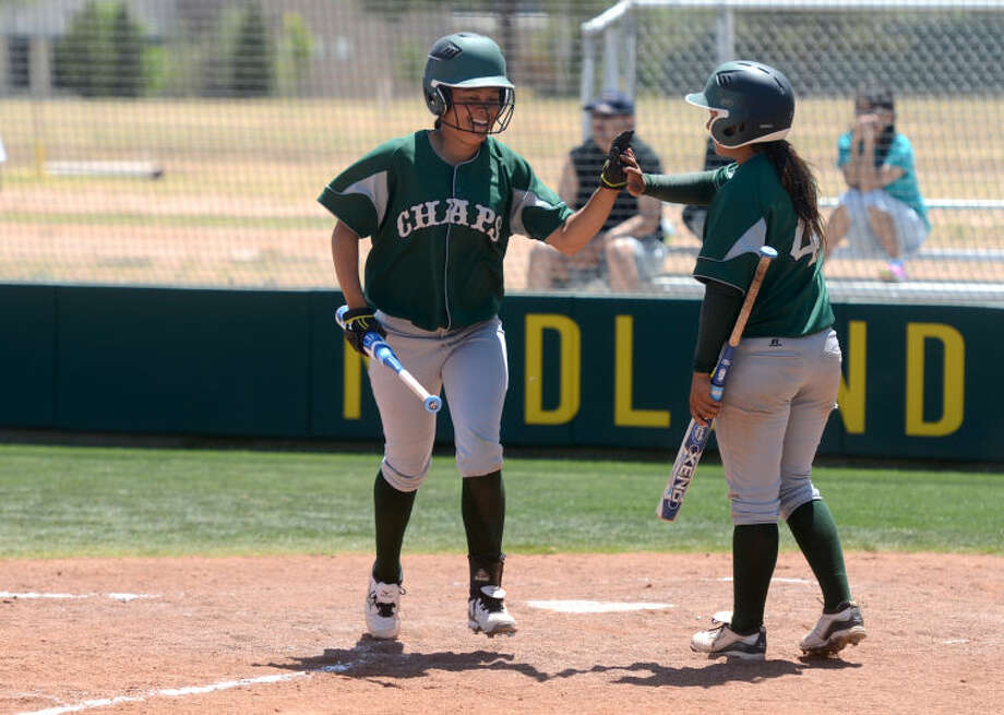 Midland College's Earnysha Scroggins (12) is congratulated by teammate Maya Varela (4) after scoring a run against Luna Friday at the MC softball field. James Durbin/Reporter-Telegram Photo: JAMES DURBIN