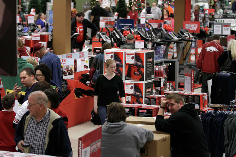 Black Friday shoppers look for bargains in the tool department at a North Little Rock, Ark., Sears store Friday, Nov. 25, 2011. Thousands of shoppers lined up at Macy's, Best Buy and other stores nationwide to buy everything from toys to tablets on Black Friday despite the economic downturn and some planned protests of the shopping holiday. (AP Photo/Danny Johnston) Photo: Danny Johnston / AP