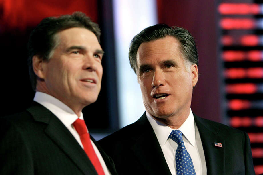 Republican presidential candidates, Texas Gov. Rick Perry, left and, former Massachusetts Gov. Mitt Romney, right, talk prior to the Republican debate, Saturday, Dec. 10, 2011, in Des Moines, Iowa. (AP Photo/Charlie Neibergall) Photo: Charlie Neibergall / AP