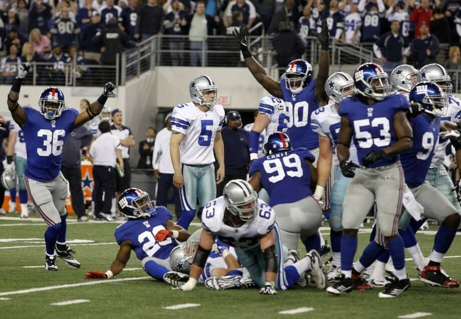 The New York Giants celebrate after Dallas Cowboys' Dan Bailey, center, misses a field goal during the final minute of an NFL football game against the New York Giants Sunday, Dec. 11, 2011, in Arlington, Texas. New York won 37-34. (AP Photo/Sharon Ellman) Photo: Sharon Ellman/Associated Press