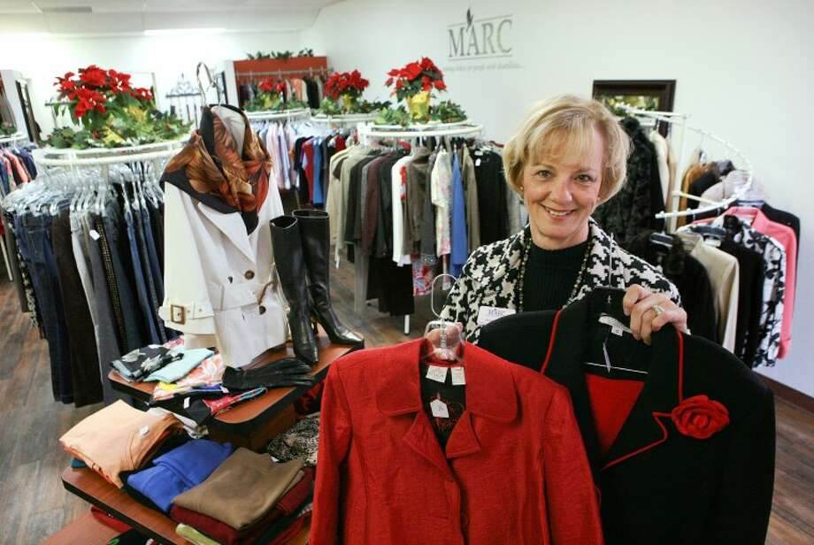 "Jean Jones, MARC development and marketing director, shows some of the clothing that will be sold in the ""The Marc-et."" The Marc-et is an upscale women's resale boutique that will sale offer clothing, handbags, shoes and accessories. The proceeds will assist in funding MARC and its vocational programs. Cindeka Nealy/Reporter-Telegram Photo: Cindeka Nealy"