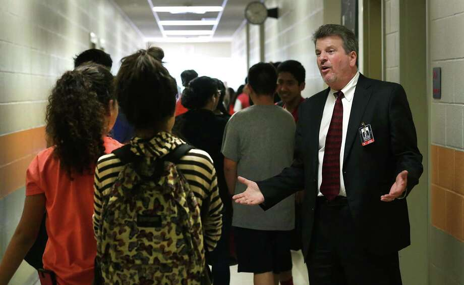 Superintendent Mark Eads greets students at Matthey Middle School, which could see improvements under a bond election. Photo: San Antonio Express-News / File Photo / San Antonio Express-News