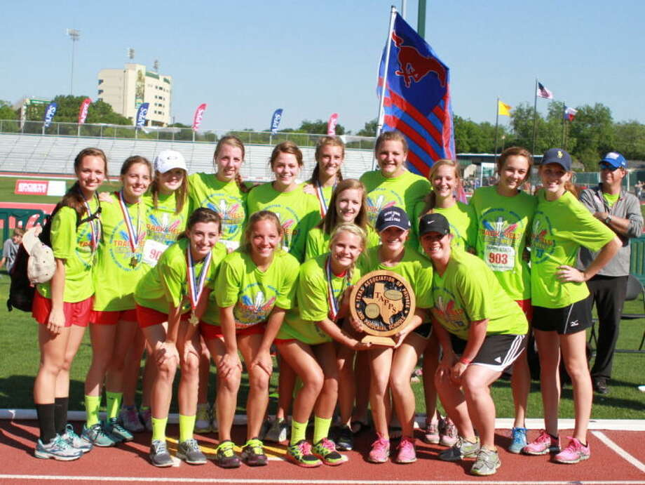 The MCS girls track teams celebrates the program's first team championships on Saturday at the Hart-Patterson Track Complex in Waco.