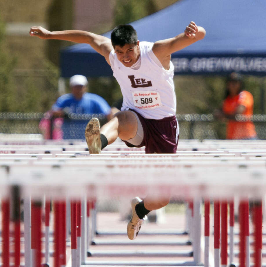 Midland Lee senior Talor Nunez jumps over the hurdle during the 110M hurdles at the Region 1 Track and Field Championship on Friday at the Linda and Terry Fuller Track Complex in Lubbock. Nunez strained his hamstring during the race and finished last in his heat. Photo: Brad Tollefson