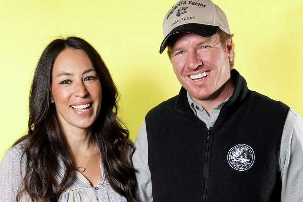 """Joanna Gaines, left, and Chip Gaines pose for a portrait in New York on March 29 to promote their home improvement show, """"Fixer Upper,"""" on HGTV."""