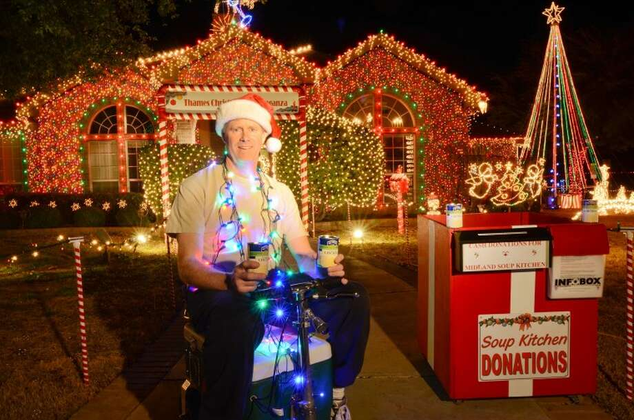 Ricky Thames has spent around 365 hours decorating his house and yard at 5600 Ashwood Court with more than 66,000 lights. Thames is asking the community to visit his display and drop off canned goods for Midland Soup Kitchen Ministry. There will be representatives from the soup kitchen accepting donations tonight and Saturday night. Photo: Cindeka Nealy/Reporter-Telegram