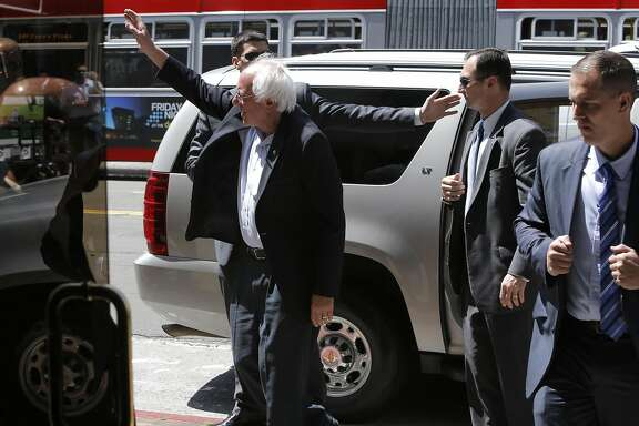Democratic presidential candidate Senator Bernie Sanders waves to supporters as he arrives at the San Francisco Chronicle on Tues. May 10, 2016 in San Francisco California, for a meeting with the editorial board.