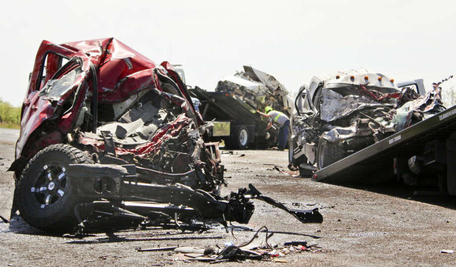Three of the four vehicles involved Saturday morning's fatal crash that killed two men were destroyed on East Highway 158 near County Road 130. Tyler White/Reporter-Telegram Photo: TYLER WHITE