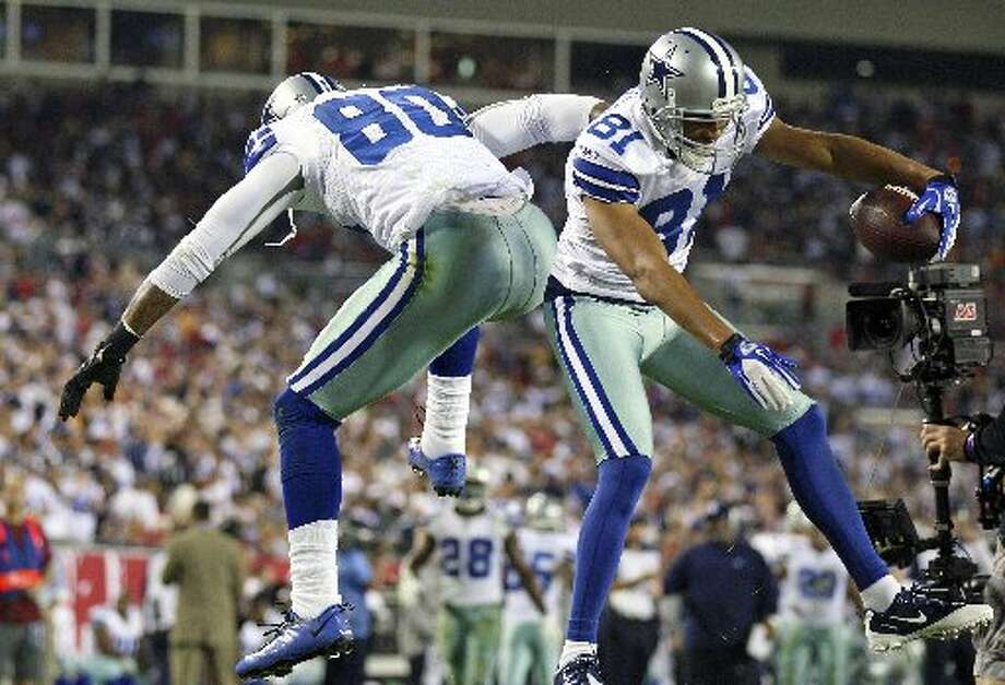 Dallas Cowboys tight end Martellus Bennett (80) and wide receiver Laurent Robinson (81) celebrate a 9-yard touchdown reception by Robinson during the first Saturday. Photo: Associated Press