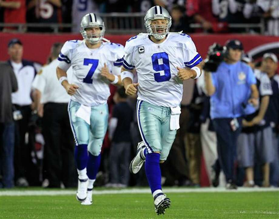Dallas Cowboys quarterback Tony Romo (9) and quarterback Stephen McGee (7) take the field before an NFL football game against the Tampa Bay Buccaneers Saturday, Dec. 17, 2011, in Tampa, Fla. (AP Photo/Chris O'Meara) Photo: Chris O'Meara / AP