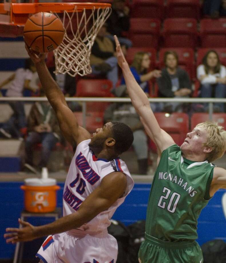 Monahans' Payton Marcum tries to block a shot from behind by Midland Christian's Devin Stricklin Monday night at MCS. Photo by Tim Fischer/Midland Reporter-Telegram Photo: Tim Fischer