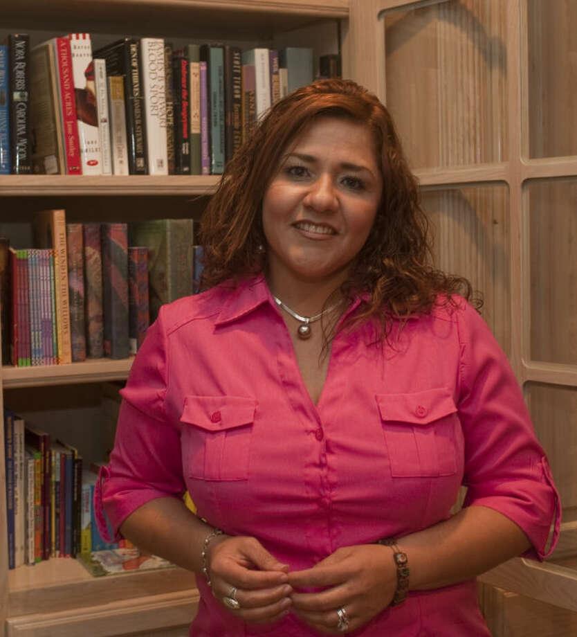 Regina Juarez is one of the success stories of Midland Need to Read. Tim Fischer\Reporter-Telegram Photo: Tim Fischer