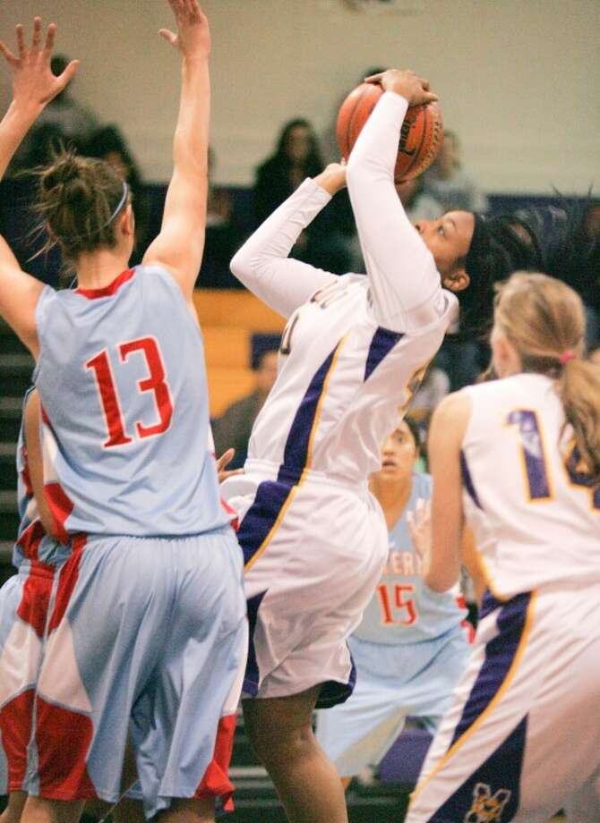 Kellyn Schneider (13) guards Sabrina Banks (40) as she attempts the shot Tuesday at Midland High School. Cindeka Nealy/Reporter-Telegram Photo: Cindeka Nealy