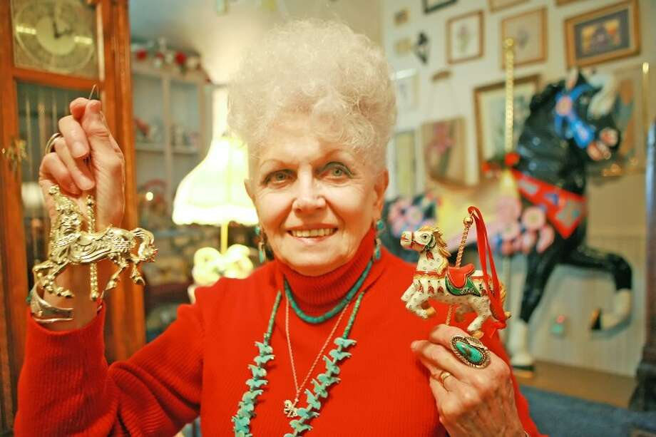 Charlene Mann has an extensive collection of more than 1,000 carousels displayed throughout her home for the Christmas season. Photo: Cindeka Nealy/Reporter-Telegram