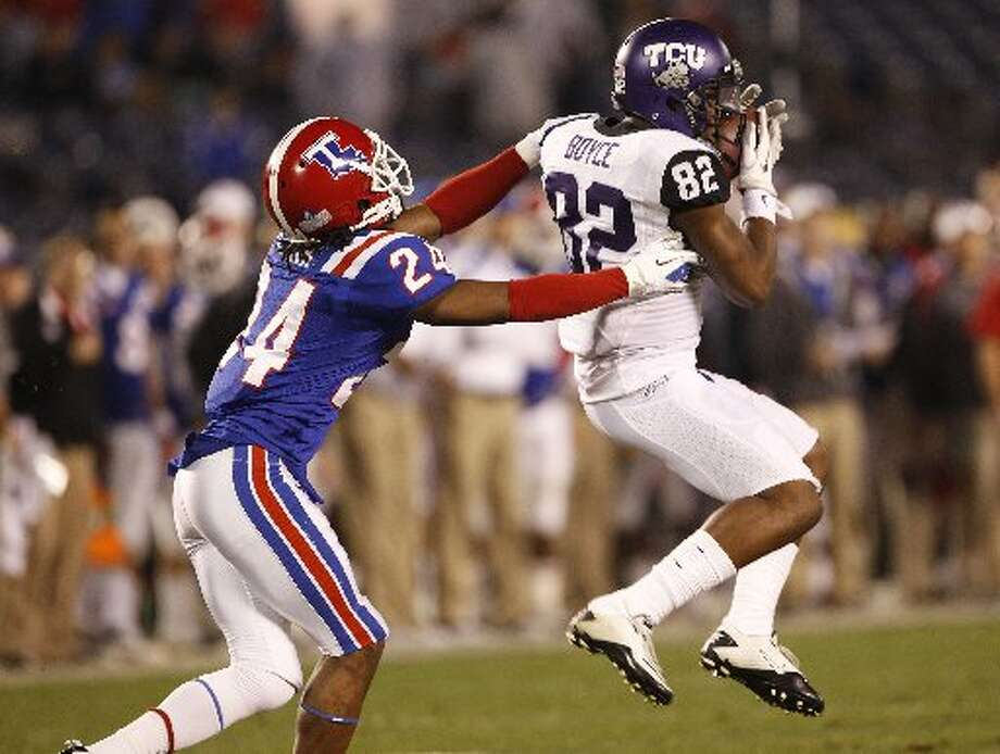 TCU wide receiver Josh Boyce pulls in a 34-yard pass as Louisiana Tech cornerback Dave Clark makes the tackle during the first half of the Poinsettia Bowl on Wednesday in San Diego. Photo: Associated Press