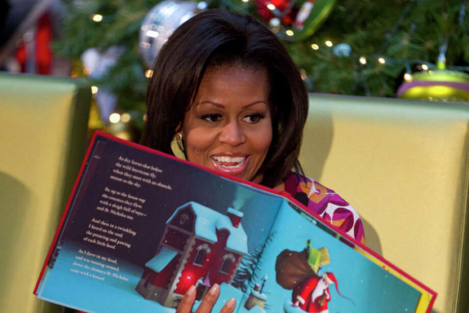 "First lady Michelle Obama reads ""The Night Before Christmas"" at Children's National Medical Center in Washington, Monday, Dec. 12, 2011. (AP Photo/Evan Vucci) Photo: Evan Vucci / AP"