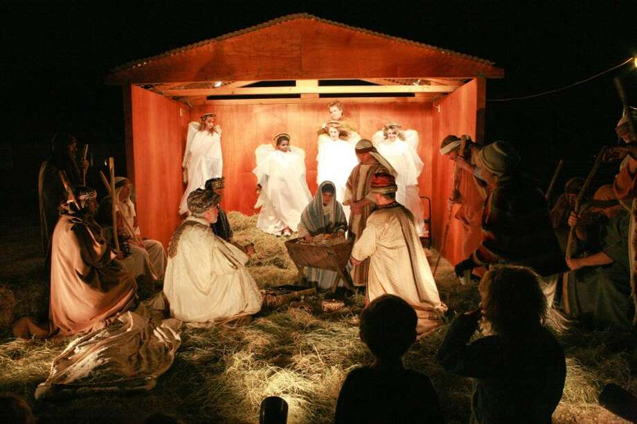 Members of First Baptist Church illustrate the night Jesus was born during their annual live nativity scene. Cindeka Nealy/Reporter-Telegram Photo: Cindeka Nealy
