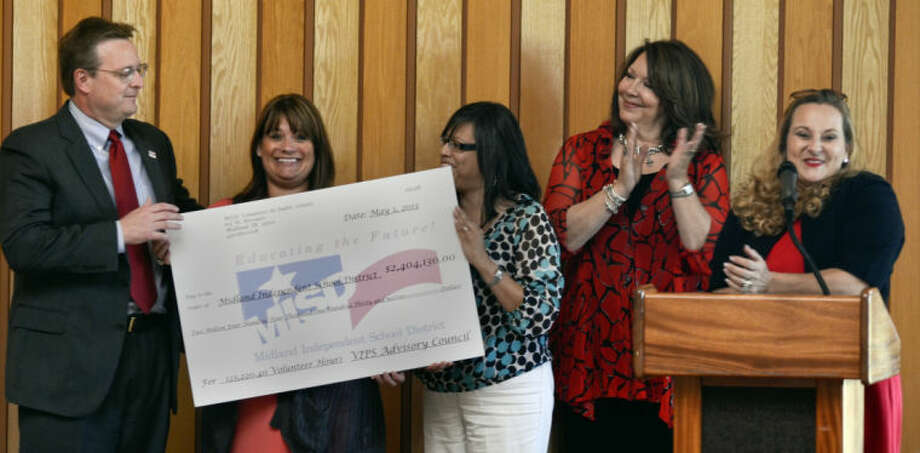 MISD VIPS, Volunteers in Public Schools, present superintendent Ryder Warren with a check for more than $2.4 million representing the hours put in by volunteers at the area schools Wednesday during a volunteer appreciation luncheon. Tim Fischer\Reporter-Telegram Photo: Tim Fischer