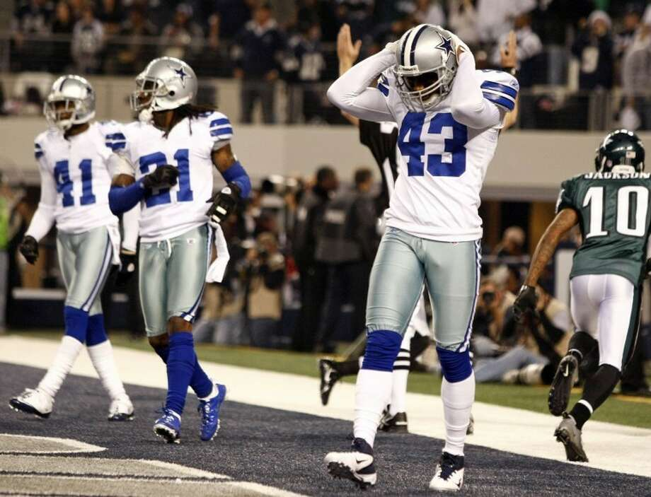 Dallas Cowboys free safety Gerald Sensabaugh (43), cornerback Mike Jenkins (21) and cornerback Terence Newman (41) react after Philadelphia Eagles wide receiver DeSean Jackson (10) scores a touchdown during the first half of an NFL football game, Saturday, Dec. 24, 2011, in Arlington, Texas. (AP Photo/The Waco Tribune-Herald, Jose Yau) Photo: Jose Yau
