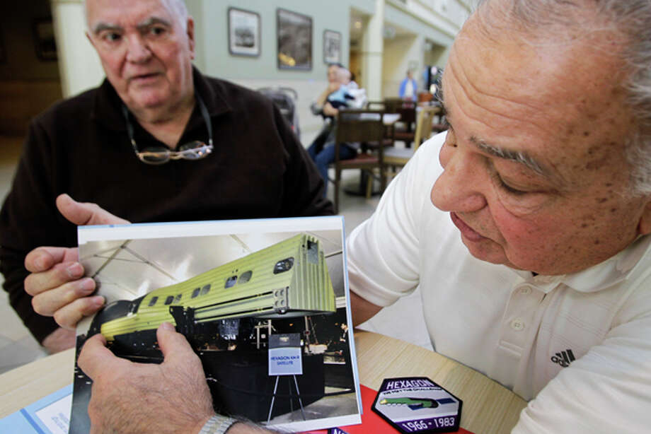 In this Thursday, Dec. 1, 2011 photo, Fred Marra, left, listens as Bob Zarba describes the camera operation of the Hexagon KH-9 secret spy satellite in Danbury, Conn. They have been meeting here for 18 years, whiling away a few hours nattering about golf and politics, ailments and grandchildren. But, until recently, they were forbidden to speak about the greatest achievement of their professional lives. (AP Photo/Kathy Willens) Photo: Kathy Willens / AP