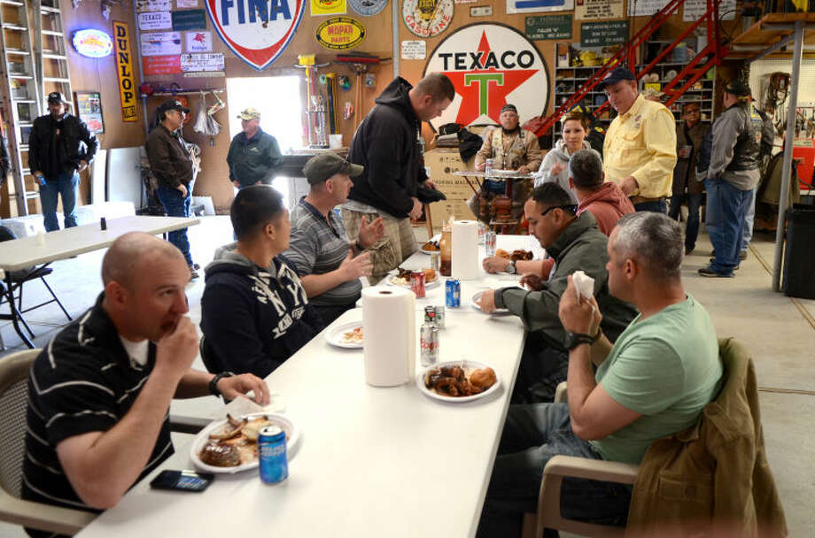 "Members of the Patriot Guard participate in a barbecue after welcoming wounded veterans at Midland International Airport Thursday as part of the ""Reel Thanx"" fishing trip program for wounded servicemen. James Durbin/Reporter-Telegram Photo: JAMES DURBIN"
