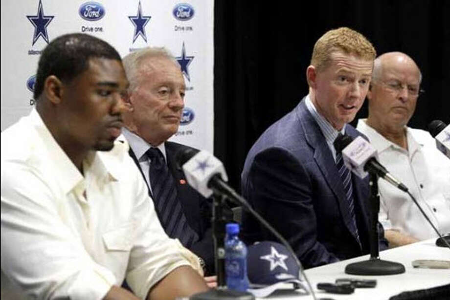 From left, Dallas Cowboys first round draft pick Tyron Smith, owner Jerry Jones, and offensive line coach Hudson Houck, right, listen as head coach Jason Garrett, second from right, responds to a question during a news conference at the team's training facility Friday, April 29, 2011, in Irving, Texas. Smith was presented a No. 77 jersey by the Cowboys, a day after the 20-year-old offensive tackle from Southern Cal was selected with the ninth overall pick in the NFL football draft. Photo: (Tony Gutierrez / AP)