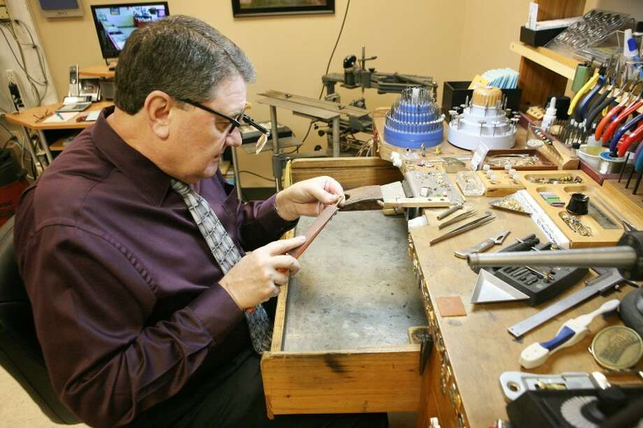 Master Jeweler Randy Burrell creates a gold and diamond pendant for a customer Dec. 21, at Randy's Rings. Burrell has been working as a jeweler in Midland for 30 years, and began working in the business as early as elementary school in Seminole. He opened Randy's Rings last year, and does jewelry repairs, orders and custom designs. Cindeka Nealy/Reporter-Telegram Photo: Cindeka Nealy