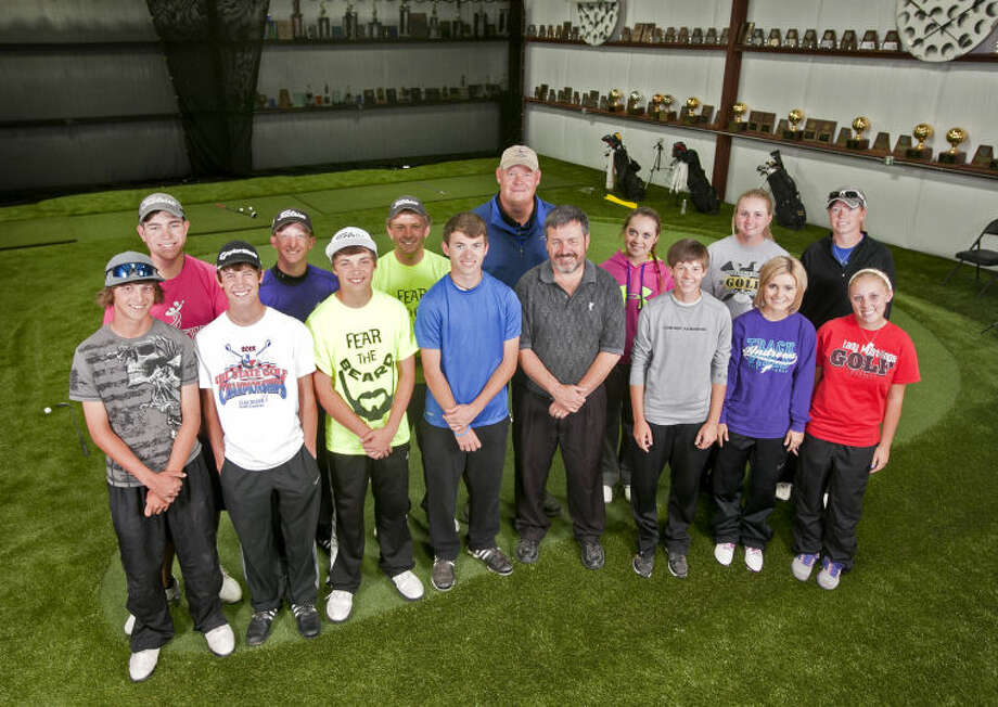 Andrews High School boys and girls golf teams pose for a portrait Thursday at their practice facility in Andrews. James Durbin/Reporter-Telegram Photo: JAMES DURBIN