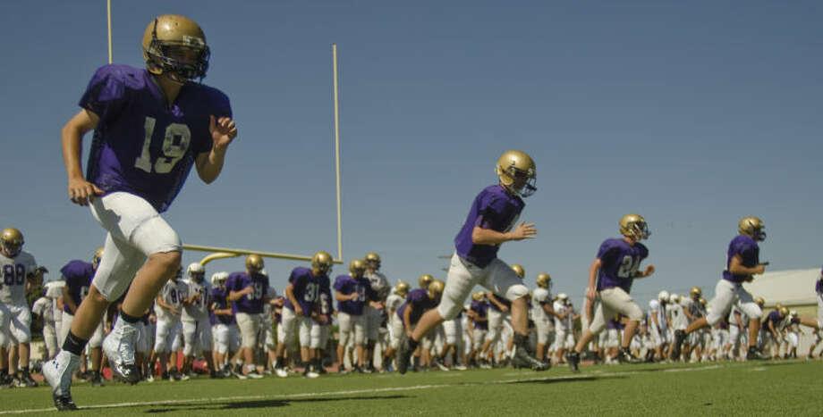Midland High players run drills Monday during the first day of spring football practice. Tim Fischer\Reporter-Telegram Photo: Tim Fischer