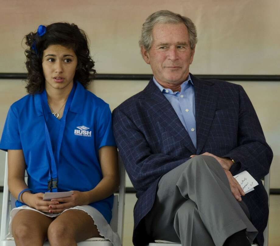 This was just a great moment before the start of the Bush Tennis Center dedication as young Hannah Rey looked extremely nervous and the typical laid back expression of former President George W. Bush leaned over to whisper something to her. Photo by Tim Fischer/Midland Reporter-Telegram Photo: Tim Fischer