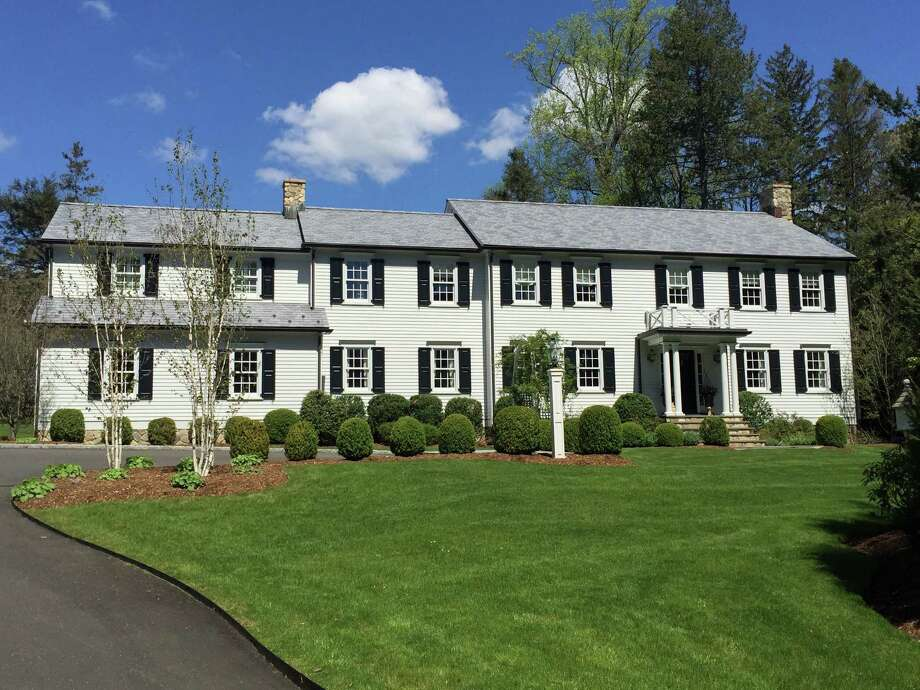 """This five-bedroom home undoubtedly resembles the """"Father of the Bride"""" house with its classic Colonial design. Photo: Contributed Photos / Hearst Connecticut Media / New Canaan News"""