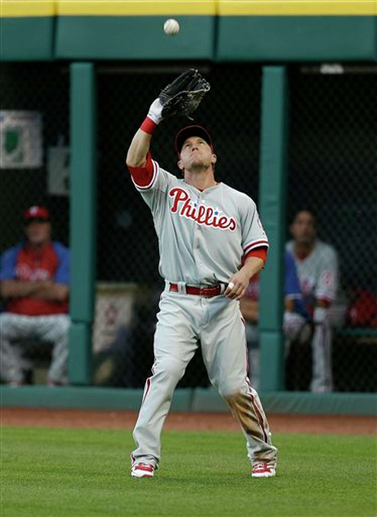 Philadelphia Phillies' Laynce Nix catches a fly ball hit by Cleveland Indians' Mike Aviles during the third inning of a baseball game, Wednesday, May 1, 2013, in Cleveland. (AP Photo/Tony Dejak)
