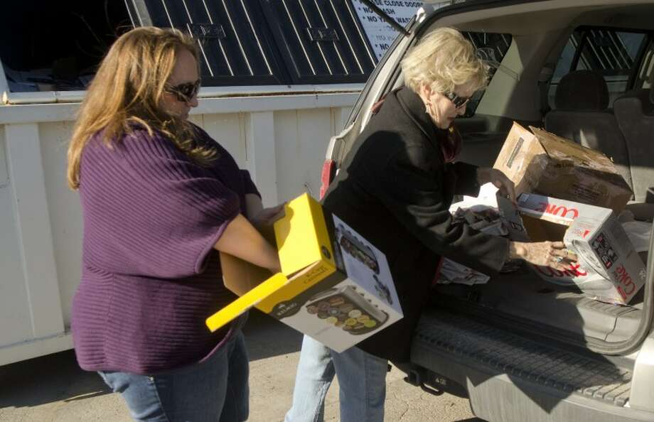Laura Stehlin helps her mother, Donna Vaden break down boxes to put in the recycle bin Wednesday morning outside Westlake Hardware on Andrews Highway. Vaden is upset she has to make a special trip to recycle items from her home in Greentree after the bins were removed from the northside WalMart parking lot to make room for a new business going in. Photo by Tim Fischer/Midland Reporter-Telegram Photo: Tim Fischer
