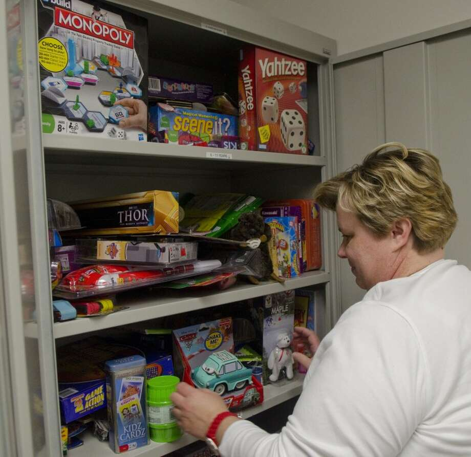 Donna Doyle, RN, BSN, clinical manager for Midland Memorial Hospital West Campus, organizes Janet�s Closet, a collection of toys available for children in the hospital to pick out something new. Photo by Tim Fischer/Midland Reporter-Telegram