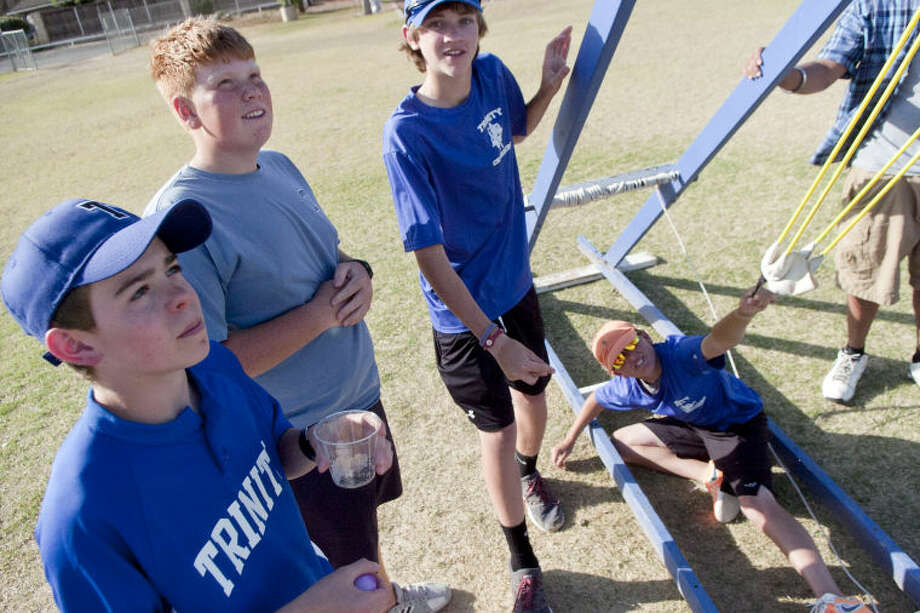 Trinity students operate a water balloon launcher during Trinity's science night Tuesday at the school. James Durbin/Reporter-Telegram Photo: JAMES DURBIN