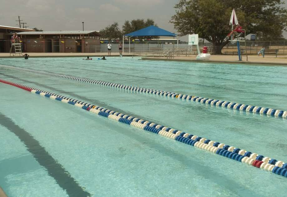 (File Photo) Doug Russell pool is nearly empty Saturday, even with Washington Pool closed because of lack of staff. Photo by Tim Fischer/Midland Reporter-Telegram Photo: Tim Fischer