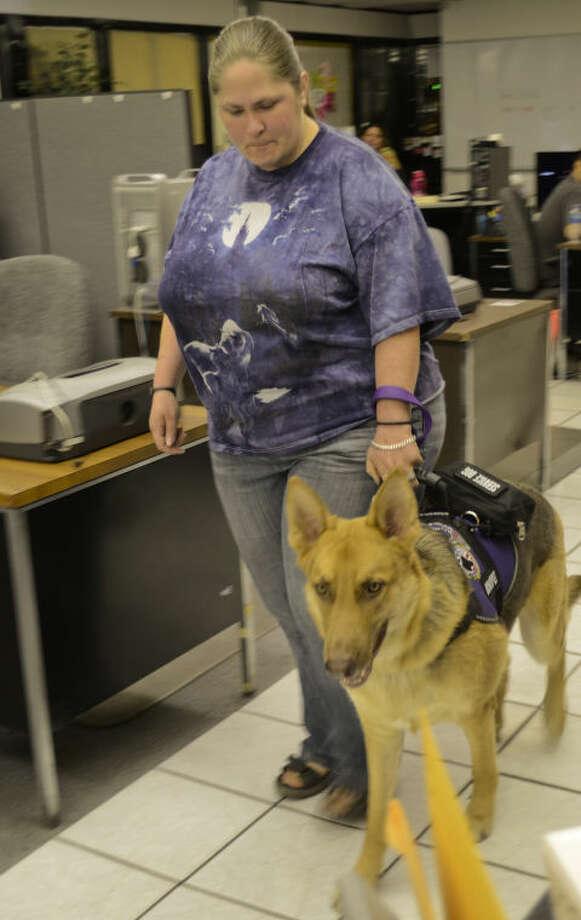 Misty Barton and her service dog, Tanner, who alerts her of an upcoming epilepsy episode. Tim Fischer\Reporter-Telegram Photo: Tim Fischer