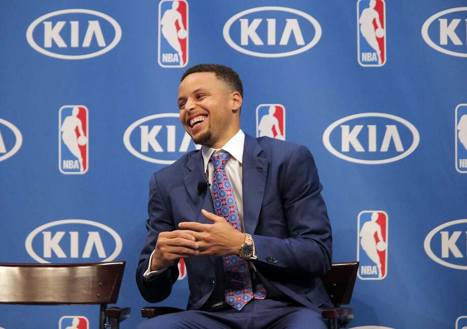 Stephen Curry smiles during remarks by coach Steve Kerr during a ceremony where he was awarded the Kia NBA Most Valuable Player award during ceremony at Oracle Arena in Oakland, Calif., on Tuesday, May 10, 2016. Photo: Carlos Avila Gonzalez, The Chronicle