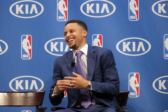 Stephen Curry smiles during remarks by coach Steve Kerr during a ceremony where he was awarded the Kia NBA Most Valuable Player award during ceremony at Oracle Arena in Oakland, Calif., on Tuesday, May 10, 2016.