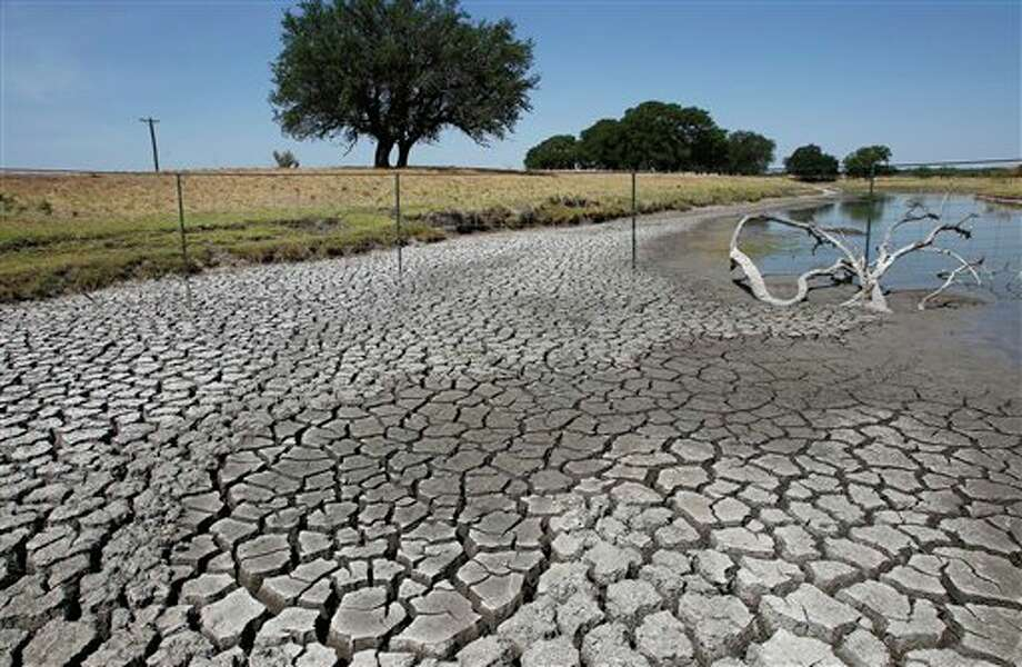 Large cracks form as Brady Creek continues to bake in the sun, Tuesday, July 26, 2011, near Eden, Texas. The area has received less than three inches of rain this year and 60 100-degree days. (AP Photo/Eric Gay) Photo: Eric Gay / AP