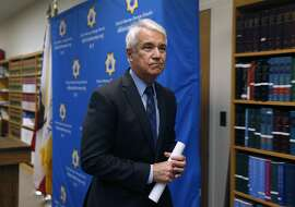 District Attorney George Gascon leaves a news conference after announcing he is filing felony charges against two Alameda County Sheriff's deputies in San Francisco, Calif. on Tuesday, May 10, 2016. Sheriff's deputies Luis Santamaria and Paul Wieber are accused of beating Stanislav Petrov leaving him seriously injured in a San Francisco alley in November 2015.