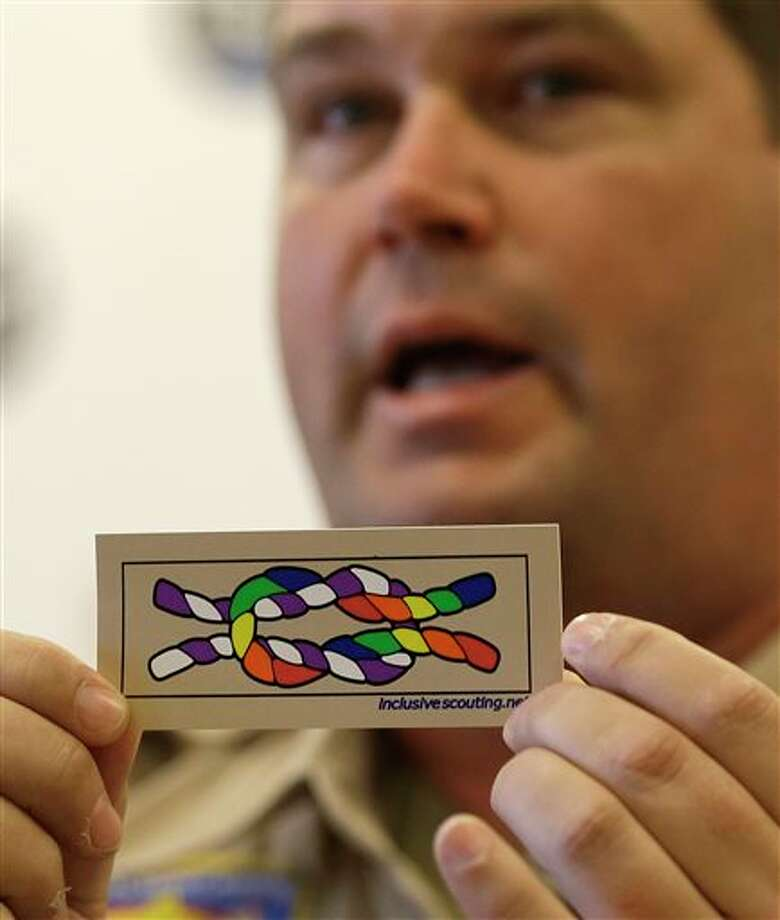 Former scout maser Mark Noel, of Hanover, NH, holds up a new merit badge of inclusion during a press conference at the Equal Scouting Summit being held near where the Boy Scouts of America are holding their annual meeting Wednesday, May 22, 2013, in Grapevine, Texas. Delegates to the Boys Scouts of America meeting are expected to address a proposal to allow gay scouts into the organization. (AP Photo/LM Otero) Photo: LM Otero / AP